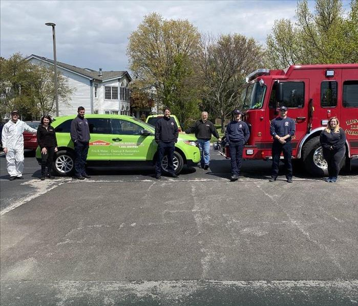 SERVPRO car and a fire truck.