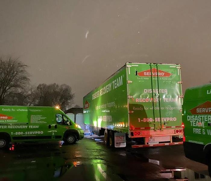 SERVPRO vans parked outside while it's snowing.