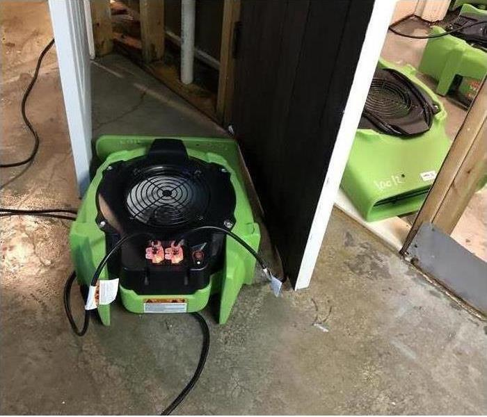 air movers between door of a home